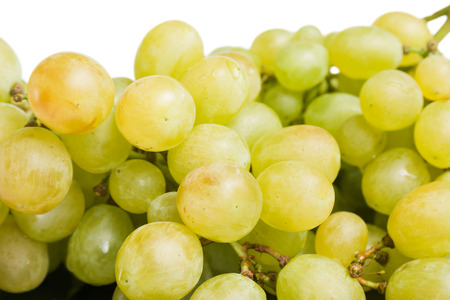 Grapes. Big bunch of fresh ripe sweet grapes close up on white background. Stock Photo