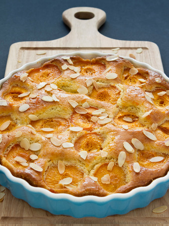 Apricot tart on a wooden chopping board