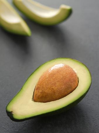 pip: Fresh sliced avocado on dark background Stock Photo