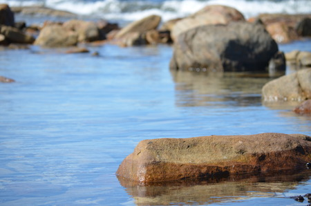 seawater: tranquil seawater pool with rocks Stock Photo
