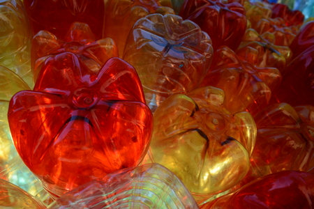 enviroment: red yellow clear plast bottles with light shining through