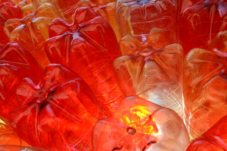 shining through: red yellow clear plast bottles with light shining through