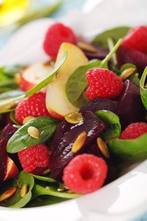 Fresh salad with spinach, raspberries, beets and apples. photo