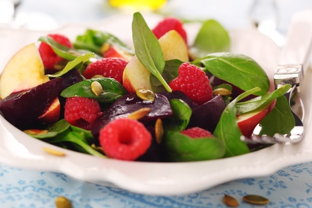 spinach salad: Fresh vegetarian salad with spinach, raspberries, beets and apples.
