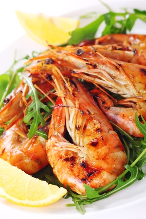 shrimp: Fresh grilled shrimps with lemon on white plate Stock Photo