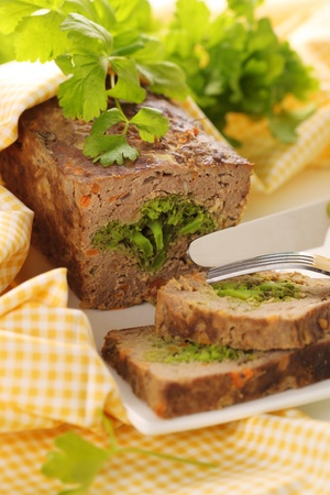 meatloaf: Meatloaf with broccoli and carrots.