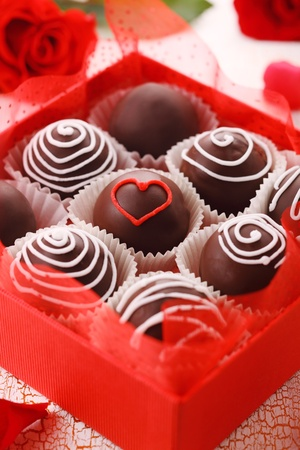 confections: Delicious chocolate pralines  in red box for Valentines Day