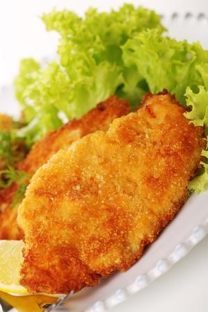cutlet: Wiener Schnitzel on white plate close up
