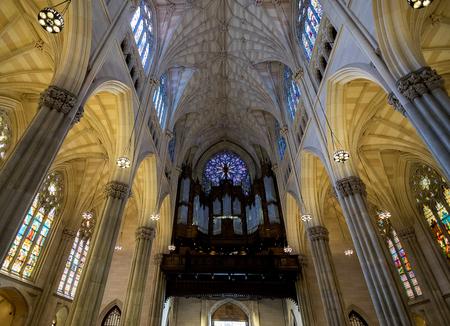 pipe organ: New York City Saint Patricks Cathedral Interior Rose Window and Pipe Organ