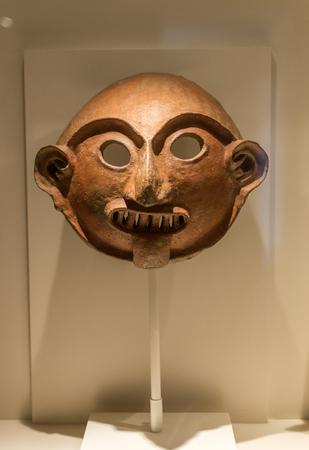 Pre Colombian Art Museum mask artifact in Cusco, Peru.