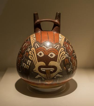 Pre Colombian Art Museum pot artifact in Cusco, Peru.