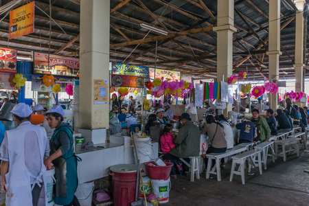 Colorful San Pedro market eatery in Cusco, Peru. Editorial