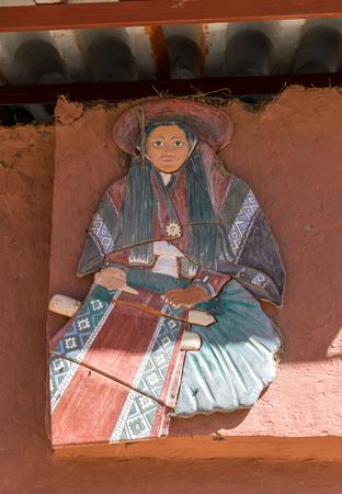 Wall art outside textile market in Chinchero, Peru. Редакционное