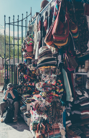 Colorful San Pedro market goods in Cusco, Peru. Редакционное
