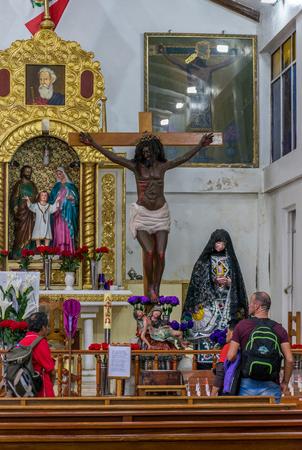 Black Jesus in the Virgin Del Carmen Spanish church in Aguas Calientes town square in Peru.