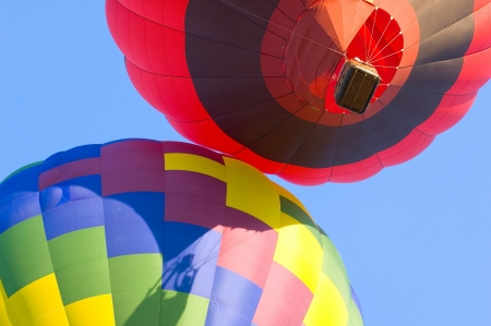 Looking upwards at colorful hot air balloons