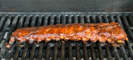 Barbecue Baby Back Ribs cooking on a BBQ Grill Stock Photo