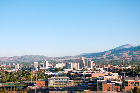 Image of the skyline of Reno, Nevada with the University of Nevada Reno in the foreground.