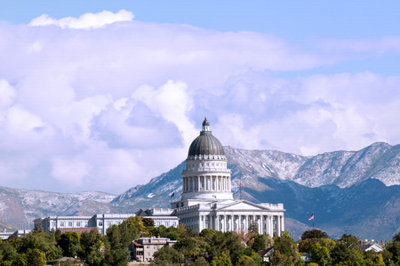 Image of the Utah State Capitol Building against the background of the Wasatch Mountains with a storm rolling in. Stock Photo