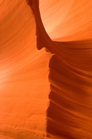 Sunlight reflected off of the red rock curves of the Antelope Canyon Slot Canyons in Page, Arizona. This shot was taken in Lower Antelope Canyon.   Antelope Canyon is Mother Natures work in progress. The canyon is carved from the flash flood waters of th Stock Photo