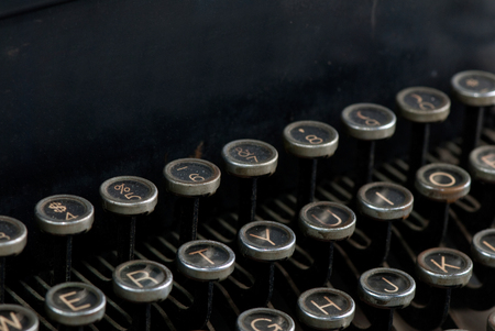 Keys on an old rusty typewriter with room for copy above the keys