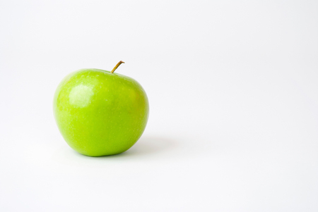 Green apple isolated on white. Room for text