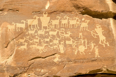 The Hunters Panel is a petroglyph created by the Freemont Indians and is located in Nine Mile Canyon Utah.  The petrogylph is also referred to as the Cottonwood Panel and The Great Hunt Stock Photo