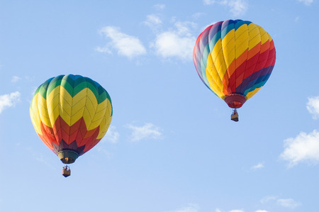 Two hot air balloons soaring in the air Stock Photo