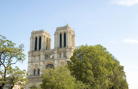 Afternoon image of Notre Dame de Paris, often known simply as Notre Dame Cathedral. The structure is a Gothic cathedral on the eastern half of the Île de la Cité in Paris, France.   Notre Dame de Paris (French for Our Lady of Paris, meaning the church i Stock Photo