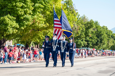 Editorial caption: Provo, USA - July 4, 2012 : Honor Guard presenting the American Flag and the Utah State Flag in the 2012 Freedom Festival parade  Honor Guard presenting the American Flag and the Utah State Flag at the front of the Freedom Festival Para