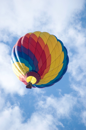 Hot air balloon flying in the clouds