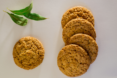 Top view of several oatmeal cookies with bay leaf Stock Photo
