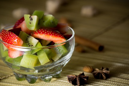 Fresh mix of kiwi and strawberries in a bowl