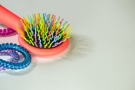 grooming product: Colorful hairbrush with holders for hair