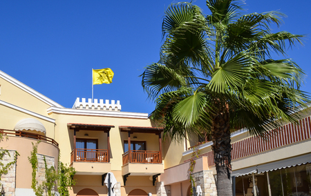 byzantine: Byzantine yellow flag over the building in Greece. Stock Photo
