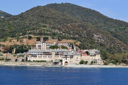 Orthodox Greek monastery on Mount Athos. View from sea. Xenophon. Stock Photo