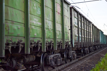 Freight train, railway wagons with motion blur effect. Transportation, railroad. Stock Photo