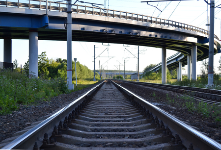 Railroad tracks under the automobile overpass