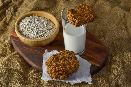 Fresh oatmeal cookies with milk Stock Photo