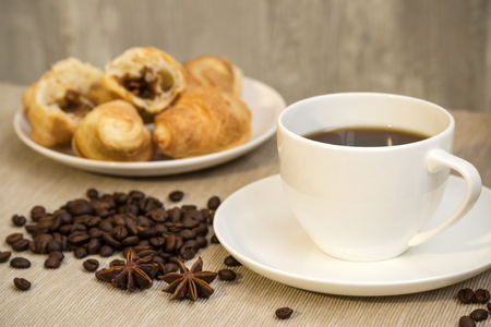 Coffee cup with croissant for breakfast