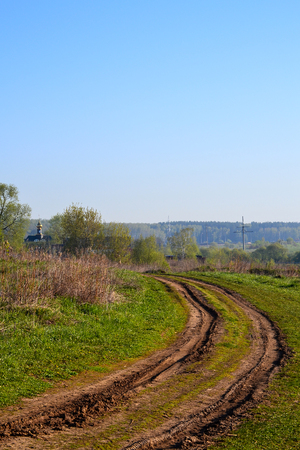 dirt road leading to the church. Russia