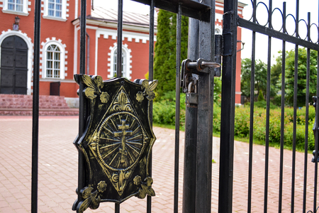 Fence with a cross around the Orthodox Church