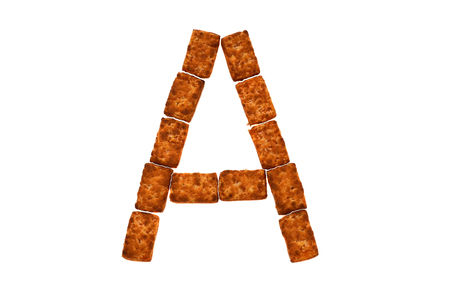 Alphabet made up of cookies on a white isolated background. letter A