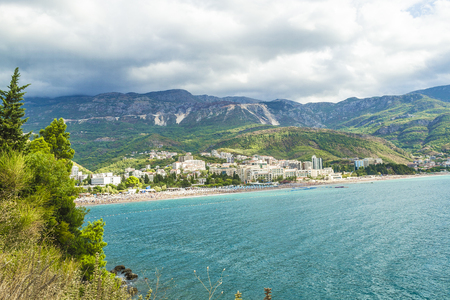 Sea view of the bay from the mountain. Low clouds over the mountains. Montenegro. The Budva Riviera