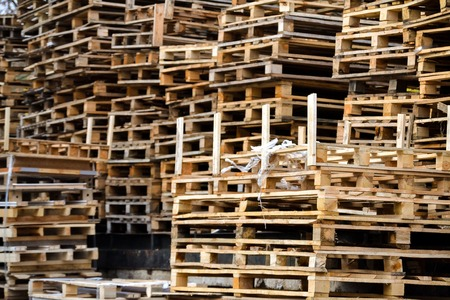 many wooden pallets in confusion close up Stock Photo