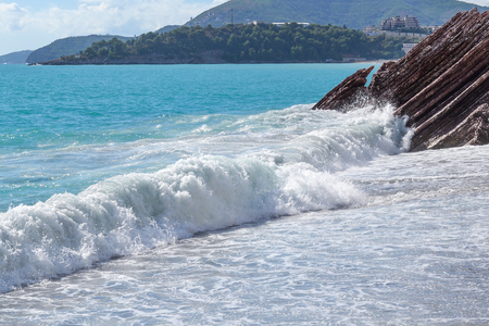 Nice view of the sea. Large foamy waves. The sea on a sunny day. Adriatic Sea. Montenegro