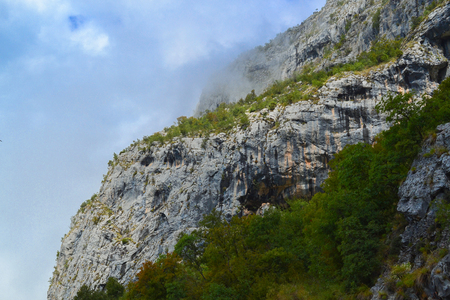 Mountain landscape. Mountains and clouds below the rocks. Montenegro