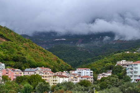 Becici, Montenegro, View of the city and mountains. Low white clouds over the city Stock Photo