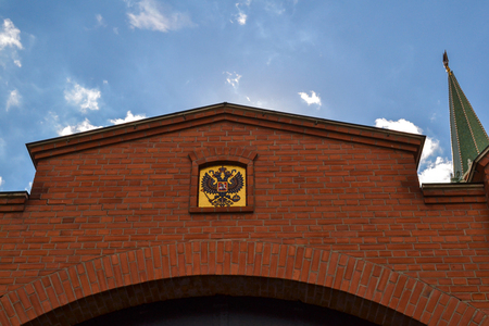 The emblem of Russia above the gates in the Kremlin wall. Moscow