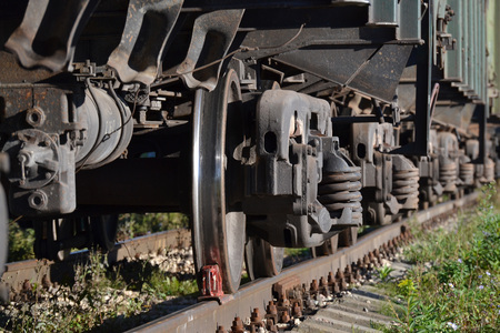 Wheels of a freight railway car close-up. Russia